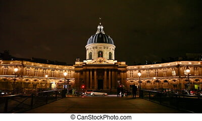 Institut de France, night view from first iron bridge across...