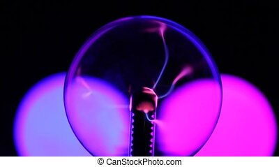 close-up shot of plasma ball with blue and pink blots on...