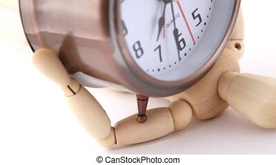 wooden doll press down under alarm clock, rotating on white