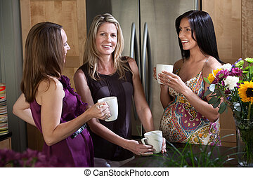 Two Pregnant Women with Friend - Two pregnant women enjoy...