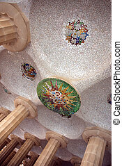 Mosaic ceiling - Hall with mosaic sun at ceiling, at Guell...