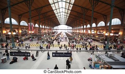Passengers walk in Paris North Station