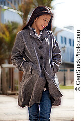 Woman Smiling Wearing a Long Coat O - Pretty Woman Smiling...