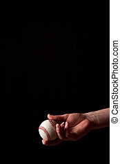 Tossing a Baseball - A boy tosses a baseball isolated on...