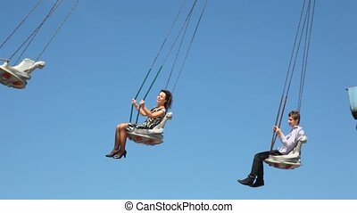 Couple are on merry-go-round.