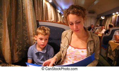 Mum and on choose something in the menu - Mum and little son...