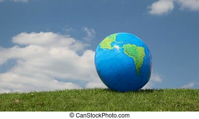 Globe looking ball waving by wind on grass - globe looking...
