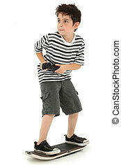 Video Game Skateboard Player Child - Attractive young boy on...