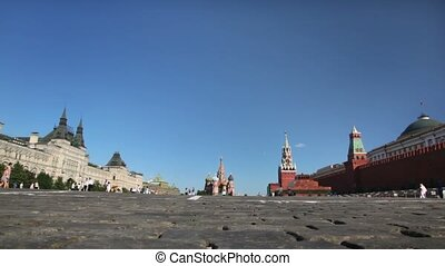 Red Square view from brick ground with tourists walking...