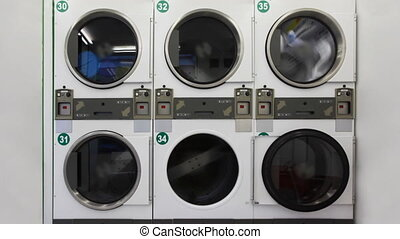 Washing machines in public laundry room - large washing...