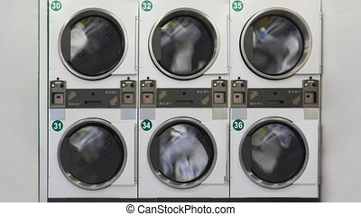 Large washing machines in public laundry room - six large...