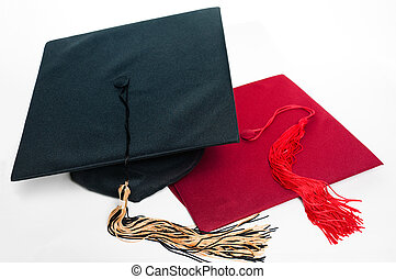 Black and red graduation caps with tassels.
