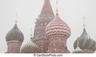 Saint Basils Cathedral at Moscow Red Square under showfall -...