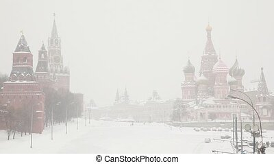 Moscow Kremlin and Saint Basils Cathedral under snowfall