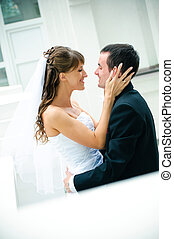 groom and bride embrace look against each other tenderness...