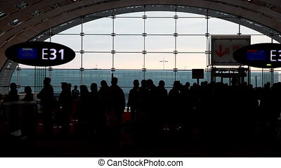 Silhouettes of people in boarding room - silhouettes of...
