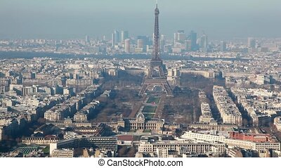 Eiffel Tower in middle of old and new buildings city Paris...