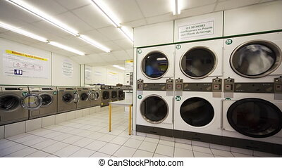 Public laundry with large washing machines - public laundry...