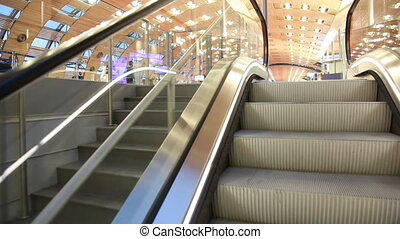 Steps of escalator, raising in great hall Paris airport -...