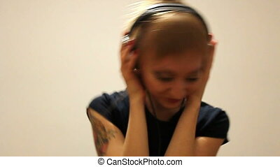 woman is listen to to the music