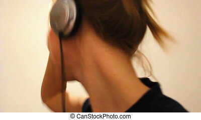 woman is listen to to the music - Young beautiful woman is...