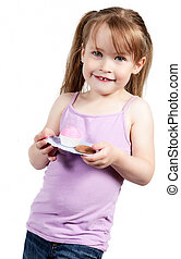 Little girl holding cupcake isolated on white background
