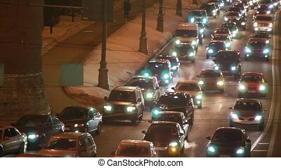 cars in hard traffic jam on street of Moscow at night