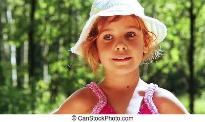 girl standing in summer woods
