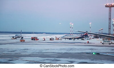 Area for aircraft at airport, machine cleans snow - area for...