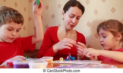Woman learn children sculpt from plasticine