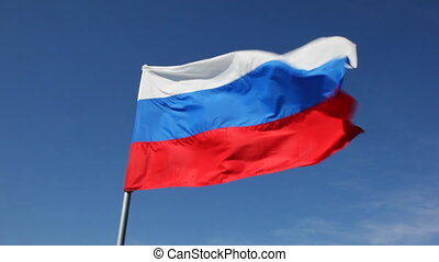 Big Russian tricolor flag flutters in wind - big Russian...