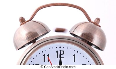 close-up shot of ringing alarm bell clock on white