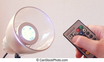 Adjustment different color on LED lamp with remote...