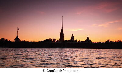 Silhouette Petropavlovskaya Fortress on bank of Neva in white nights