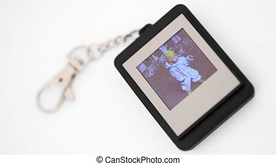 electronic trinket with liquid-crystal display showing...