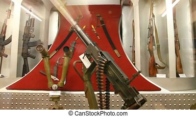 military machinegun, stereo riflescope behind the glass in museum