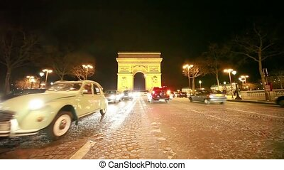 Cars move near The Arc de Triomphe - PARIS - JANUARY 1: Cars...
