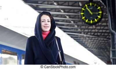 Woman at the train station waiting