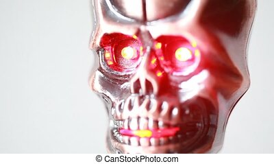 The revolving lighter in shape of cranium with glow eyes