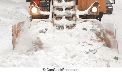 Municipal snow removal machine grabs snow from the street -...