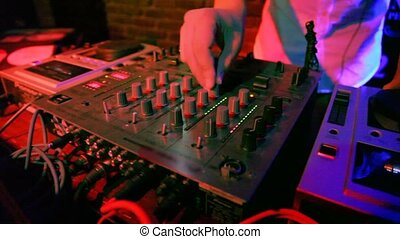 Close-up of pult behind which works the Dj. - Close-up of...