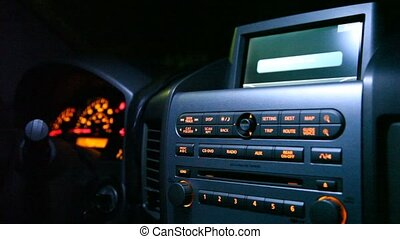 Close-up of control panel in car. - Close-up of black...