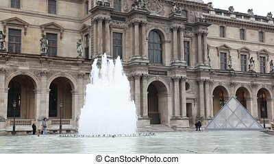 Tourists walk in front of Louvre - PARIS - DECEMBER 31:...
