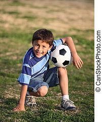 Latino boy with soccer ball - Authentic happy Latino boy...