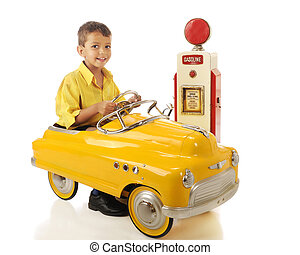 Happy Little Driver - A happy preschooler driving a bright...