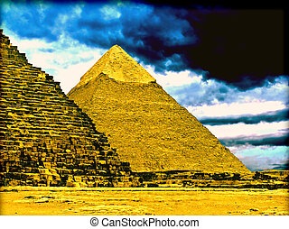 Pyramids of Gizeh near Cairo in Egypt on a cloudy day