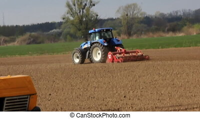 Ploughing field. Country landscape.