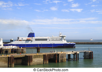 Ship leaving Dover harbor in England - Blue and white ship...