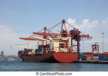 Large container ship in a dock at industrial port logos and...