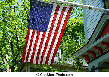 American Flag Outside A House In Small Town USA